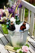 Beer and lemonade in an ice bucket