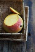 A sliced mango in a basket