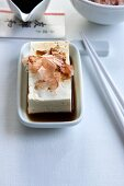 Tofu in soy sauce with dashi (flaked fish) and shaved bonito (dried fish)