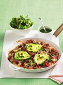 Pan-cooked salami pizza topped with egg