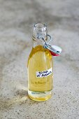 A bottle of homemade acacia syrup