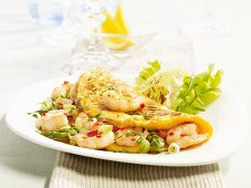 An omelette with king prawns and asparagus