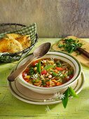 Colourful vegetable soup with ramsons