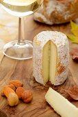Sliced Chevre, nuts, bread, white wine