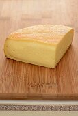 Munster cheese on a wooden board
