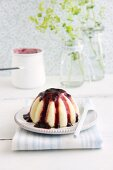 Semolina pudding with blueberry sauce