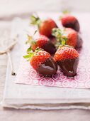 Chocolate strawberries on pink paper