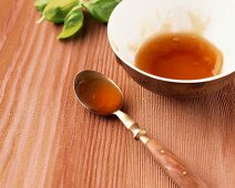 Apple and basil jam in a bowl and on a spoon