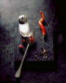 Salt, dried rose petals, a chilli pepper and peppercorns