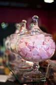 Marshmallows in glass jars on a counter