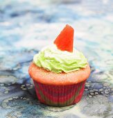 Watermelon Cupcake with Green Frosting and a Piece of Watermelon