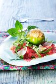 Carpaccio with grated Parmesan with a green tomato filled with sorbet