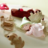 A fairytale figure and leaves made from marzipan