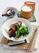 Braised, marinated pork fillet with vegetables on a bed of rice