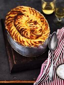 A meat and fish pie with a potato lid