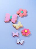 Various flower-shaped and butterfly-shaped biscuits