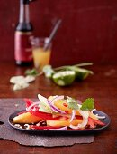 Mango salad with pepper and coriander