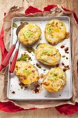 Stuffed potato skins topped with melted cheese