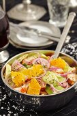 Chicken and avocado salad with oranges, red onion and dill