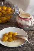 A sweet honey and milk sauce with stewed Mirabelle plums