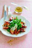Rocket salad with strawberries, parmesan, balsamic vinegar and pine nuts