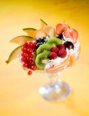 Fruit dessert with whipped cream and biscuits