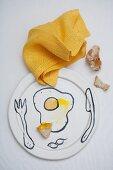 A still life with smears of egg yolk