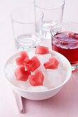 Heart-shaped ice cubes made from fruit juice