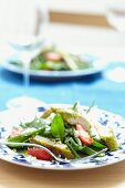 Green bean salad with strawberries and breaded chicken
