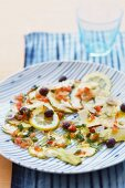 Artichoke carpaccio with olives and lemons