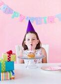 Portrait of girl (6-7) celebrating birthday