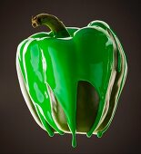Studio shot of green pepper covered with green paint
