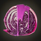 Studio shot of red cabbage covered with purple paint