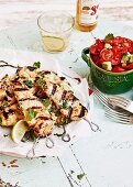 Chicken skewers with tomatoes and avocado salsa