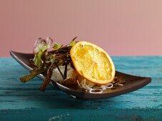 Rice noodle salad with a slice of orange
