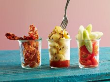 Gnocchi with fried bacon and tomato-fennel salad in glasses