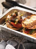 Barbecued chicken and vegetable sandwiches in an aluminium tray