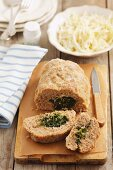 Pork meatloaf with a spinach and feta cheese filling
