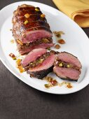Duck breast stuffed with fruit and nuts