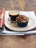 Chocolate crumble cupcake with a cup of coffee