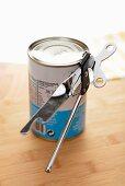 A tin with a tin opener
