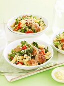 Penne with meatballs, rocket and tomatoes
