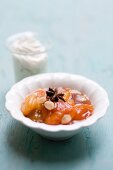 A compote of dried apricots, star anise and slivered almonds