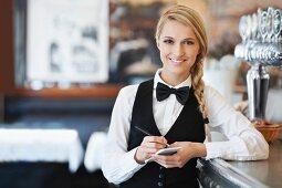 A waitress writing down an order