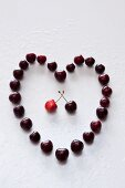 A heart made of sweet cherries