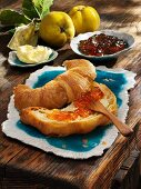A croissant with quince jam and butter