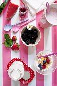 A breakfast of milkshake, berry muesli and fresh milk
