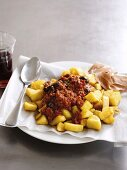 Chipped potatoes with chilli con carne