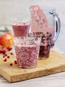 Yoghurt shake with blackcurrant and pomegranate