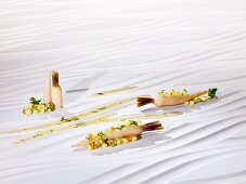 Parsley roots cooked 'sous vide' on a bed of root vegetables with yuzu broth